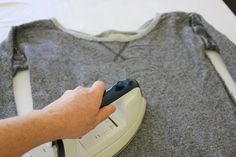 """If you're going for an 1980s look, be it for a costume party or just as a throwback to a different era, cutting a sweatshirt is one of the easiest ways. An '80s sweatshirt conjures up the iconic image of Jennifer Beals in """"Flashdance"""" — and all the sweatshirt-inspired fashion that followed. Cutting a sweatshirt …"""