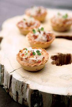 Brides: Classic Fall Wedding Style :Bacon-and-onion tartlets garnished with micro watercress sit atop a cross section of a tree trunk used as an hors d'oeuvres tray.