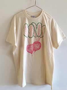 Hand Printed and Hand Drawn! This is a 100% cotton screen printed t shirt with hand drawn pink Chioggia beets and leafy green tops. Its perfect for