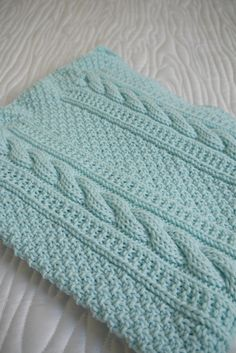 "I wanted to share a quick look at my latest knitting project - a blanket for my sister and brother-in-law's ""expecting"" friends.  This was a project with a deadline and did it ever test my speed-kn..."
