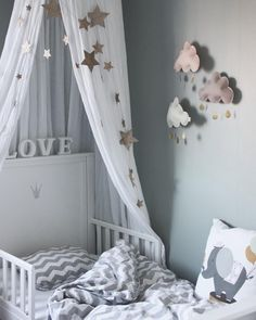 White canopy and gold falling star garland #numero74 #kidsdecor #kidsroom & Amazing styling featuring Numero74 White canopy and star cushions ...