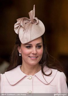 The Duchess of Cambridge topped her blush pink McQueen coat with a coordinating percher hat for Commonwealth Day.  The hat, a tear drop shaped straw beret, was trimmed with pleated silk twists.