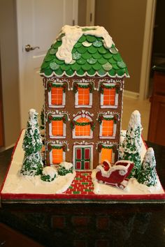 """This is my first from scratch gingerbread house.  It is 18"""" tall.  Completely edible.  Candy clay roof shingles, butterscotch windows, ..."""
