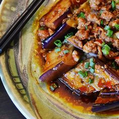 Ma Po Eggplant in Garlic Sauce with Ground Pork, Rice Vinegar, Sambal Oelek, Cornstarch, Soy Sauce, Asian Eggplants, Peanut Oil, Kosher Salt, Chicken Stock, Sake, Sugar, Toasted Sesame Oil, Bean Sauce, Scallions, Garlic Cloves, Peeled Fresh Ginger, Steamed Rice.