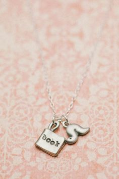 Adorable bookworm necklace. Wearing this with a T-shirt & jeans.