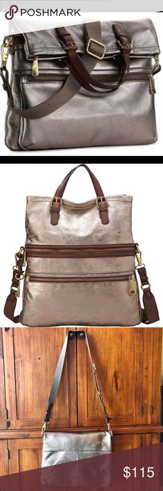 Fossil Explorer Bag- metallic leather New without tags Fossil Explorer Bag- Metallic gunmetal leather exterior with brown interior.   🗝Removable shoulder strap  🗝Lots of pockets and different ways to style! 🗝Perfect condition  Dimensions: 15in width, 6in height, 3in depth Fossil Other