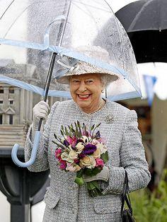 Even Queen Elizabeth holds her own umbrella....ahem, Mr. President.