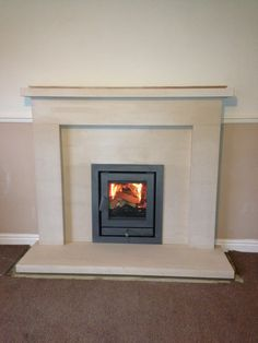 Chesney's inset wood burning stove and limestone fireplace installed in Wakefield Inset Fireplace, Wood Burner Fireplace, Fireplace Built Ins, Limestone Fireplace, Bedroom Fireplace, Living Room With Fireplace, Fireplace Ideas, Small Gas Fireplace, Fireplace Suites