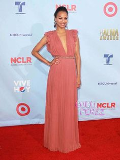 Zoe Saldana was looking extra Latinalicious last night at the ALMA Awards.  The Words actress was as pretty as a rose in a deep-plunging Gucci Resort gown that...