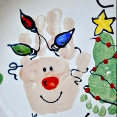 Christmas hand and foot prints. Just did this on ornaments at Dish'N and it is so cute!
