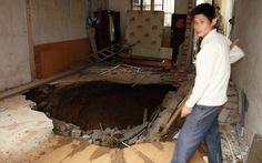 In November 2010, a giant crater suddenly opened up in a family home in Guilin, southern China's Guangxi Province. The pit formed at around 2:30 am when the members of the family were all in bed. Homeowner Zeng Pengqi said: 'We heard a loud cracking sound and the ground was shaking. We thought it was an earthquake'. The family raced outside but was bewildered to find that no other homes were shaking; venturing back inside they discovered that a huge 2m deep pit had mysteriously opened up in…