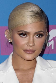 Make-up trickery: The lipkit queen used liner to overdraw her pout for the event...