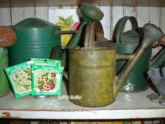 """My love for """"ViNtaGe Garden"""" started out many years ago when I lived in the Desert of all places! It began with WATERING CANS and """"branc. Vintage Love, Vintage Green, Shabby Vintage, Metal Watering Can, Watering Cans, Shed With Porch, Vintage Gardening, Milk Cans, Rustic Gardens"""