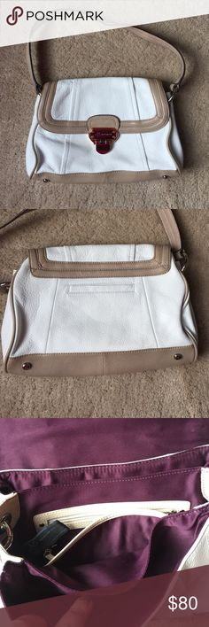 B Makowsky This is a gorgeous white and tan leather handbag! Plum lining! Has 3seperate compartments inside aswell as 2 pockets! Has great space for a smaller bag! b. makowsky Bags Shoulder Bags