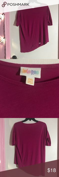 LuLaRoe Irma High Low Solid Magenta Size XXS This is a LuLaRoe Irma High Low size XXS in a beautiful magenta color. In great condition. Perfect addition to a LuLaRoe lovers closet. LuLaRoe Tops Tees - Short Sleeve