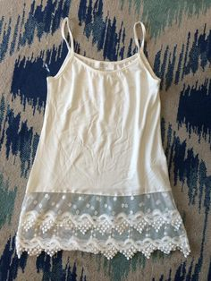 Lace Top Extender Tank - White www.chocshoe.com lace peeks out of bottom of any shirt to add that touch of lace. Other colors available!
