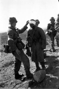 German medic bandaging a Red Army solider in Titovka on 29 June, 1941.