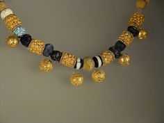 Gold and Glass Bead Necklace Discovered in a Woman's Sarcophagus in ancient Fidene north of Rome 6th-5th century BCE