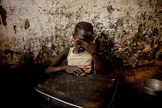 Abun, southern Sudan: A girl weeps while clutching a suitcase in a makeshift camp for internally displaced people