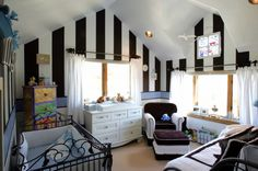 The large vertical striped wall with baby blue horizontal accent is really striking