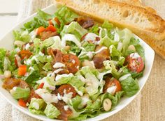 White Bean Salad  If you have nine ingredients, including cannellini beans, red bell peppers, romaine lettuce, bacon and Simply Dressed® Ranch Salad Dressing, you can toss together this amazing salad.  From Marzetti Kitchens℠.