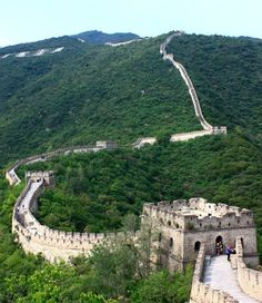 The Great Wall winds the green mountains.