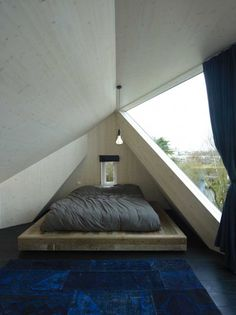 Love the tiny window by the bed so the sun can hit your face in the morning | Villa Rotterdam / Ooze