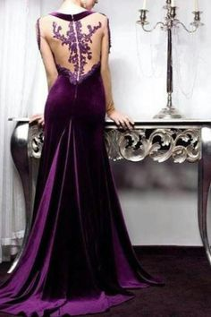 "This dress is purple. This dress is velvet. This dress has beautiful detailing on a ""open"" back. I really like this dress."