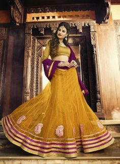 Modest Mustard Net Embroidery Patch Border Work A Line Lehenga Choli  http://www.angelnx.com/Lehenga-Choli/Wedding-Lehenga-Choli#/sort=p.date_added/order=DESC/limit=32/page=11