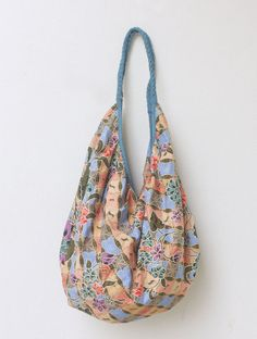 Elegant boho sling bag with blue Asian floral print by MESIMU