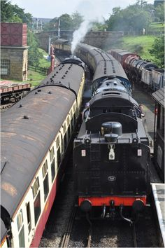 Passing trains. Steam trains arriving and departing at Goathland, a small station on the North Yorkshire moors  Joan Bryden via Antony Waller onto Trains & Boats & Planes