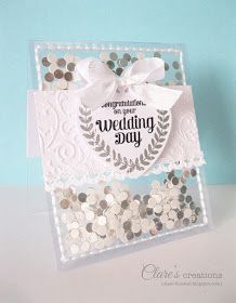 I love this handmade wedding card using white and silver and an acetate pocket for confetti!