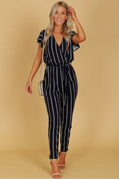 Vertical Striped Short Sleeve Jumpsuit Navy, An adorable classic jumpsuit with short sleeves, a vcut neckline, a keyhole detail along the back with a button closure, an elastic waistband and a matching fabric belt. Jumper Outfit Jumpsuits, Jumpsuit Outfit, Casual Jumpsuit, Event Dresses, Casual Dresses, Casual Cocktail Attire, Cool Outfits, Fashion Outfits, Fashion Edgy