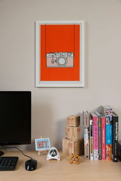 A3 risograph print of a Leica M3, 35mm camera in fluorescent orange soy-based ink on 100% recycled paper.
