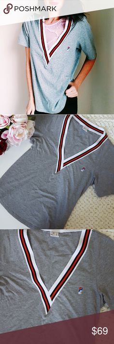 PE Nation | Australian sport company V neck top In good condition! Beautiful PE Nation deep V neck top. Australian sport company.  Good quality and chic design! Size large. Used item- inspected for quality. Any wear or use is shown in pictures. Bundle up! Offers always welcome:) PE Nation Tops