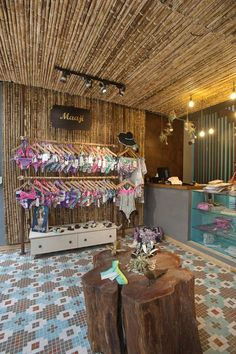 Lagunarosa store by Plasma, Bogotá Colombia store design. Retail store design with modern twist in vintage tile design combined with rustic wood. Boutique Design, Design Shop, Boutique Decor, Beach Boutique, Retail Store Design, Retail Shop, Lingerie Store Design, Beach Stores, Store Interiors