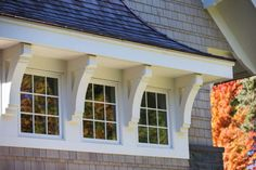"Lake House Interior Ideas - corbels between windows -- ""Trim Paint Color"" (Benjamin Moore Winter White) Cottage Exterior, Exterior Trim, Exterior Design, Corbels Exterior, Roof Design, Exterior Paint, House Trim, Dormer Windows, Shed Dormer Window Ideas"