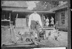 Man at home with hunting dogs, Washington County, Georgia, 1906