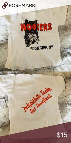 Authentic Hooters Uniform T-shirt w/ Short Sleeves Perfect For A Halloween Costume from your favorite restaurant  Or If You Just Want To Dress Up For Your Man.   Tee Shirt Size: One Size Fits All  %100 Cotton  Very good Pre-owned condition  No rips or stains From a clean, smoke free home Hooters Tops Tees - Short Sleeve