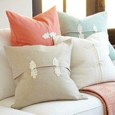 neutral frog knot pillows