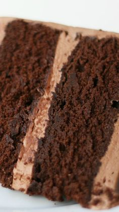 Quintessential Chocolate Cake with Whipped Chocolate Frosting Recipe ~ Says: This cake is rich and moist and fudgy but also light and delicate. It seems contradictory but try it and you will see what I mean.