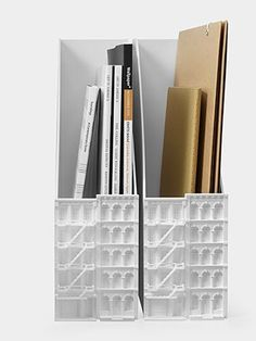 Cardboard magazine holders will never suffice after these architectural boxes.  #refinery29 http://www.refinery29.com/dorm-room-essentials#slide-2