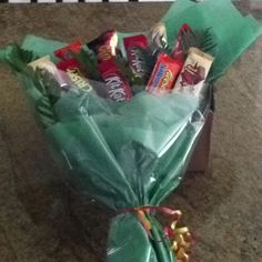 Candy bouquet. Change to protein bars and peanut butter crackers?