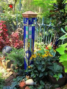 """Make a fun mosaic garden accent! Sydney Minor's mosaic tower has become one of our outstanding """"Flea Market Gardening July Challenge"""" projects! Mosaic Garden Art, Glass Garden Art, Mosaic Art, Mosaic Glass, Stained Glass, Mosaic Mirrors, Garden Yard Ideas, Diy Garden Projects, Mosaic Projects"""