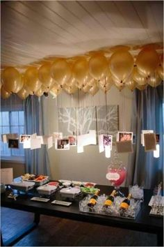 Pictures hung from balloons over a table. Really cute! by DenyMacMart