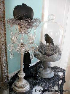 How To Get A Gothic Style Haunted Halloween Mantel - Fox Hollow Cottage Black Birds Silver Pumpkin Decor silver cake stand glass dome jar Retro Halloween, Spooky Halloween, Vintage Halloween Decorations, Holidays Halloween, Halloween Crafts, Happy Halloween, Halloween Cloche, Halloween Stuff, Halloween Masquerade