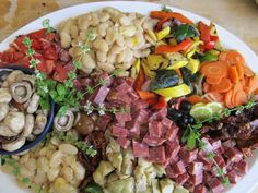 Tapas platter - grilled veggies, marinated beans, cured meats, artichokes pickled items, olives, manchego cheese