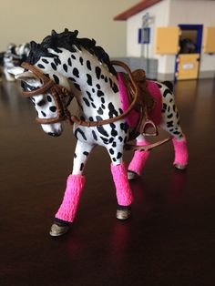 I have wanted one of the new 2015 Schleich horses for a while. So, I got this beautiful Appaloosa mare and made a set with a pink pad and matching polo wraps, the saddle and bridle is from Schleich