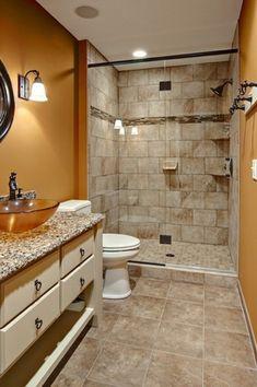 Craftsman 3/4 Bathroom with Vessel sink, Wall sconce, partial backsplash, three quarter bath, Raised panel, stone tile floors