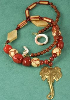 Brass elephant necklace with unique shell clasp in our Artfire shop.